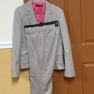 Tan pinstriped pant suit